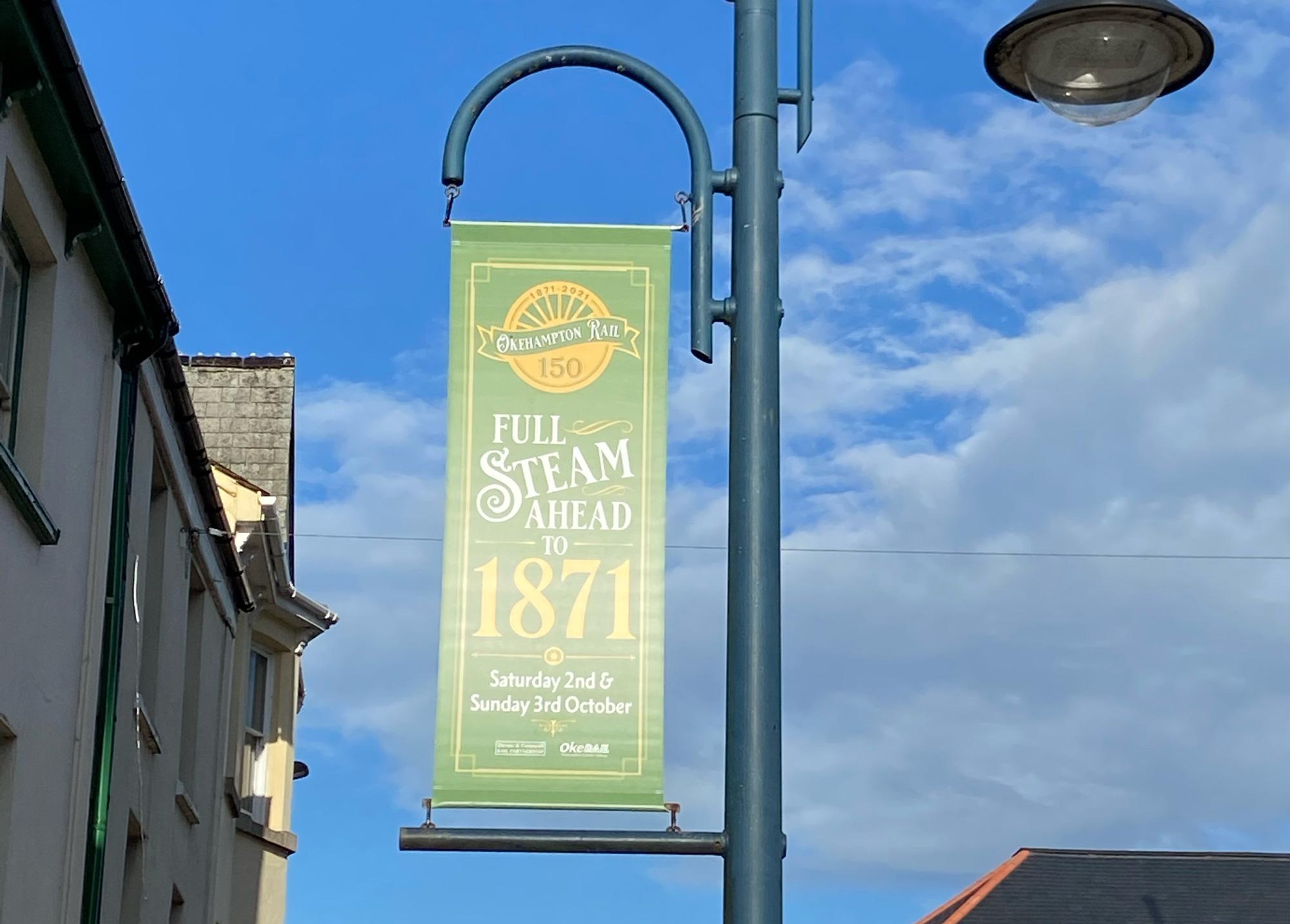 Street banner celebrating Okehampton 150th railway celebrations