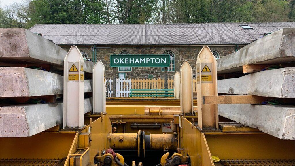 Okehampton station sign visible between sleepers